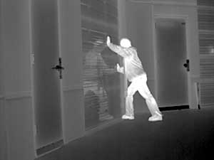 thermal-image-man-breaking-into-warehouse-300x225